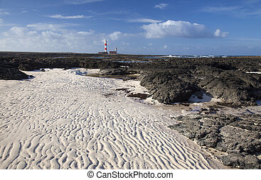 Fuerteventura, Faro de Toston lighthouse, rippled sand left...