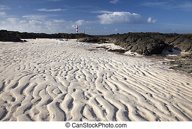 Fuerteventura, Faro de Toston lighthouse, rippled sand left...