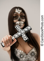Santa Muerte. Close-up of cross with rhinestones - Santa...