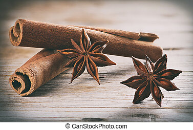 Cinnamon (cassia) sticks and Anise on wooden table