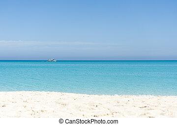 Boat sailing on blue Caribbean sea