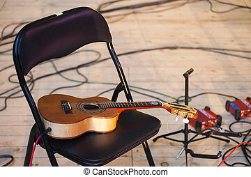 Acoustic guitar plugged in on music concert