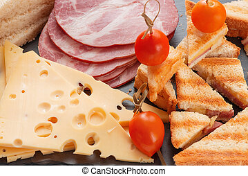 Slices of cheese, ham, bread and marinated cherry tomatoes...