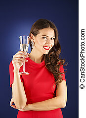 beautiful woman with glass of champagne, celebrate concept