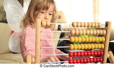 Cute little girl playing with abacus - Two years old child...