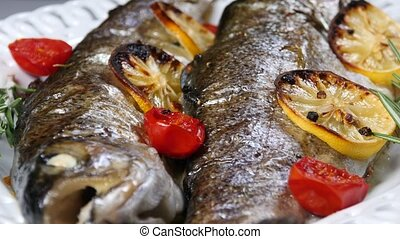 delicious trout fish baked with lemon, tomatoes and spices