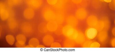 Colorful golden orange sparkling party lights bokeh...