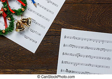 Top view Christmas music note paper with Christmas wreath on...