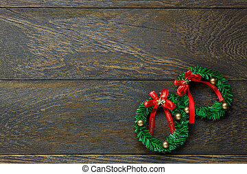Top view Christmas wreath on wooden background with copy space.