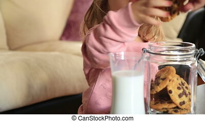 Little cute girl eating cookie - Small girl child with long...