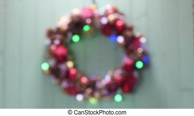 Christmas wreath on a wood background - defocused christmas...
