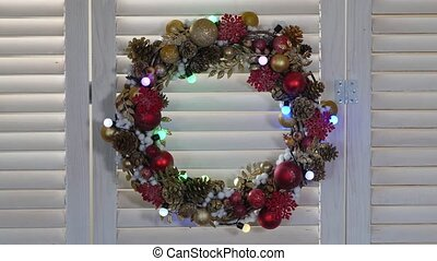 Christmas wreath on a wood background with flashing garland