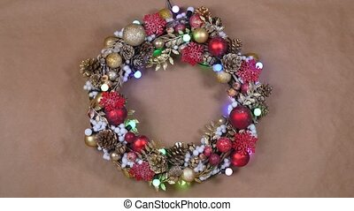 Christmas wreath on a kraft paper background with flashing...