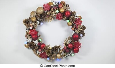 Christmas wreath on a white background with flashing garland