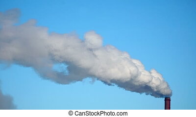 Smoke Emission From industrial Factory Pipe on blue Sky...
