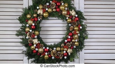 Christmas wreath on a wood background, dolly shot