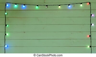 christmas lights frame, garland on a wood background