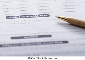 Close-up of Health Insurance Claim Application Form with pen