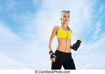 Young and sporty woman with a bottle of water - Fit, sporty...