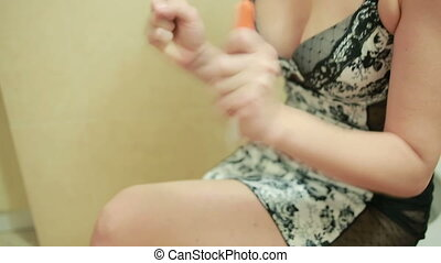 Close-up on pregnancy test. girl on the toilet in the...