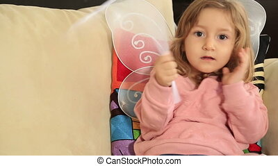 Portrait of a cute little girl with angel wing - Beautiful...