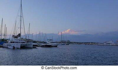 Catamaran, sailing yachts, motor boats and superyacht moored at Harbor. 4k