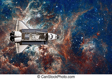 Space Shuttle flight over space nebula. Elements of this...