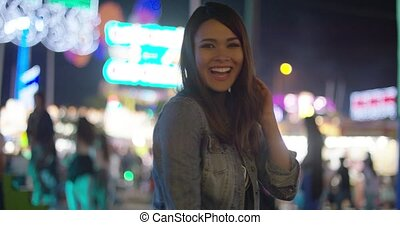 Gorgeous woman at amusement park during night - Gorgeous...