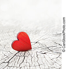 red heart on a cracked wooden background - red wooden heart...