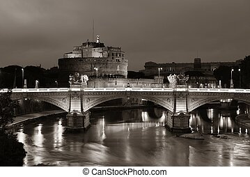 Castel Sant Angelo in Italy Rome at night over Tiber River...