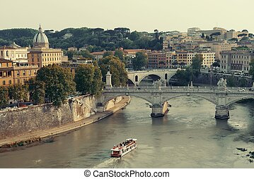 Ponte Vittorio Emanuele II and River Tiber with tourism boat...