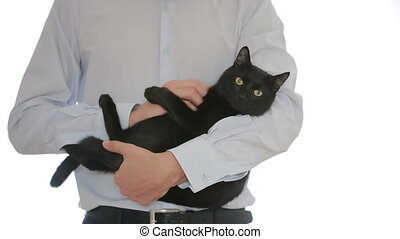 businessman holding a black cat in her arms