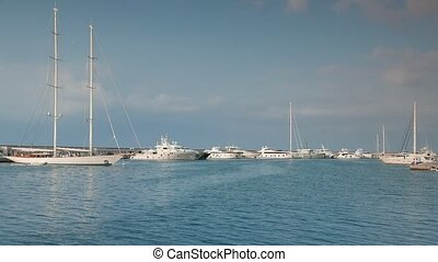 Superyachts, sailing yachts, motor boats and yachts in expedition style moored at Harbor. 4k