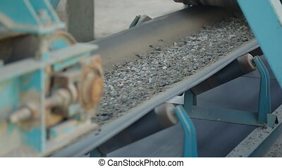 Belt conveyor moves various stone mixtures for further...