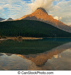 Banff National Park - Lake at sunrise with cloud and...