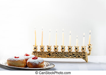 Sufganiyot for Hanukkah - Sufganiyot and nine branched...