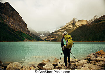 Banff National Park - A female hiker at Lake Louise in Banff...