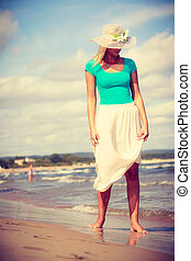 Attractive woman on the beach. - Summer time relax leisure...