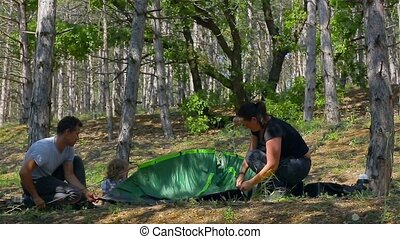 Group of children laying in tent - Caucasian dad and son...