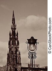Scott Monument, vintage lamp and Edinburgh city view in...