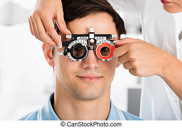 An Optometrist Checking Patient Vision With Trial Frame