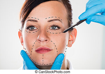 Cosmetic Surgery With Scalpel On Young Woman - Close-up Of A...