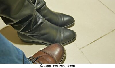 Nervously knocks foot in anticipation of something. men's...