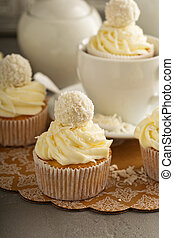 Coconut cupcakes with white frosting