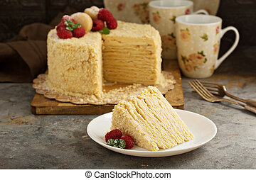 Napoleon cake with butterscotch frosting decorated with...
