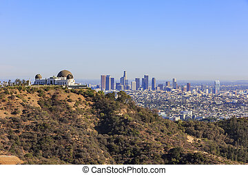 Los Angeles afternoon cityscape with Griffith Observatory,...