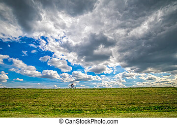 Cyclist Sava river bank - Cyclist riding a bicycle on the...