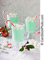Green peppermint hot chocolate with marshmallows and candy...