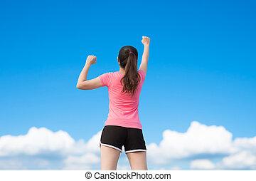 sport woman make a fist