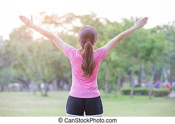 woman feel free in park